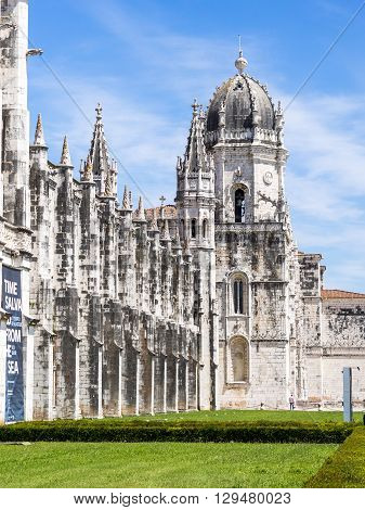 Belem Portugal - April 28 2014: Main facade of the Jeronimos Monastery in Belem Portugal. It is a Manueline style monastery and part of the UNESCO World Heritage Sites.