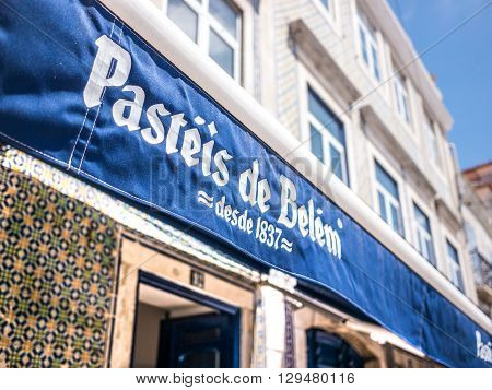 Belem, Portugal - April 28 2014: The main entrance of the Pasteis de Belem (Pastries of Belem) store. The pastries of this shop are well known around the world and a touristic destination.