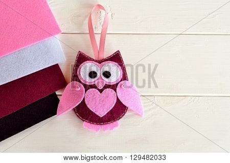 Burgundy felt owl. Nice children's toy. Felt sheets. Empty space for text.