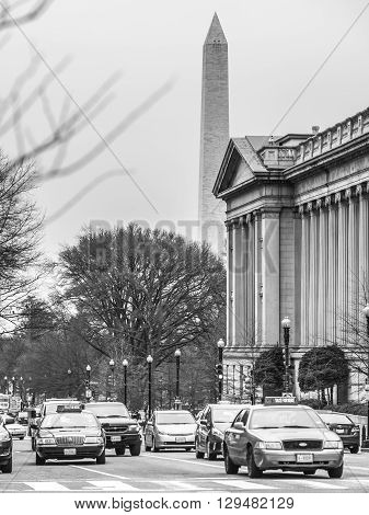 Washington D.C. - December 29 2014: A busy street in Washington D.C with the Washington monument behind.