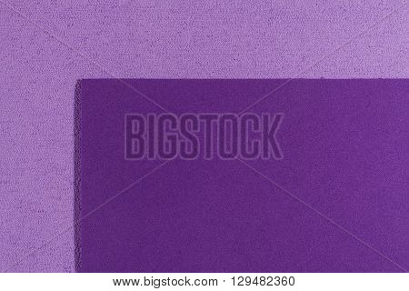 Eva foam ethylene vinyl acetate smooth purple surface on light purple sponge plush background