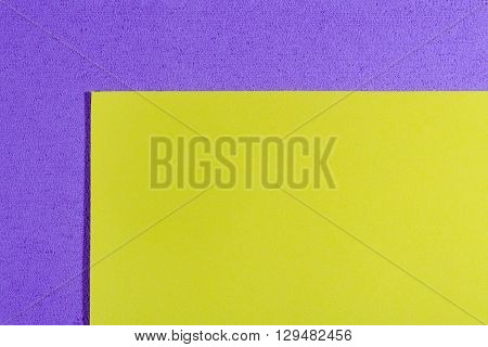 Eva foam ethylene vinyl acetate smooth lemon yellow surface on light purple sponge plush background