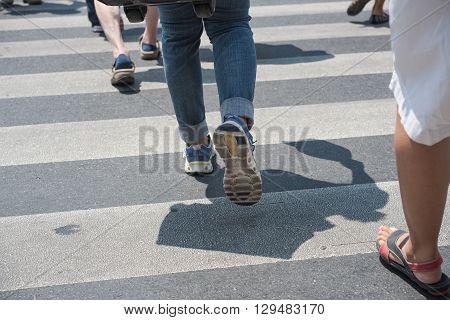 people walking on the crosswalk in the city