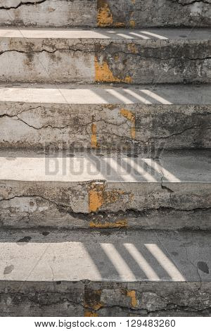 gray concrete staircase with sunshine for background.