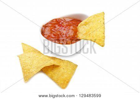 nachos and tomato dip on the white