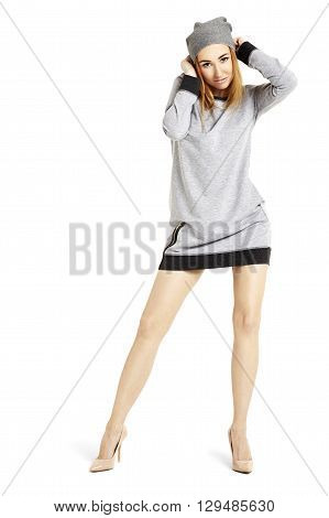 Attractive Woman In A Gray Mini Dress And Cap