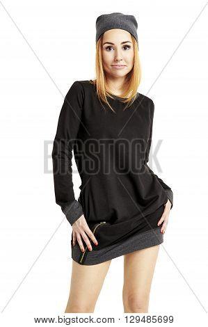 Portrait Of Girl In A Black Mini Dress And Cap