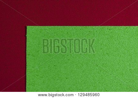 Eva foam ethylene vinyl acetate apple green surface on red sponge plush background