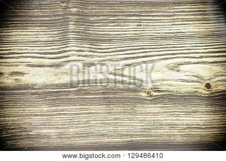 The close-up of a wooden board with a distinctive pattern and texture.