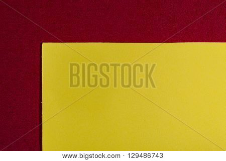 Eva foam ethylene vinyl acetate smooth lemon yellow surface on red sponge plush background