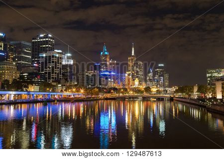 Melbourne city skyline at night with the view of Queens Bridge over the Yarra River in Victoria, Australia