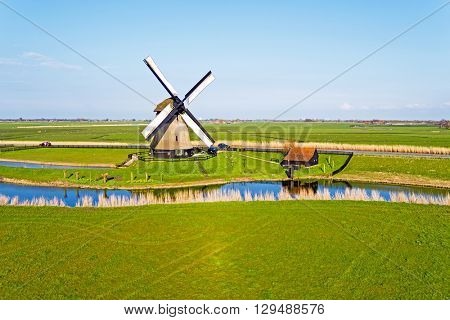 Aerial from a traditional ancient windmill in the countryside from the Netherlands