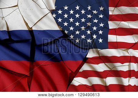 Flag of the USA and Russia on a cracked paint wall. A symbol of various conflict between these 2 nations i.e. economic military space diplomatic trade armed politic investment naval areal.