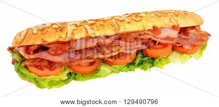 Large bacon and tomato sandwich in a crusty bread baton isolated on a white background