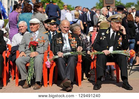 Orel Russia - May 9 2016: Celebration of 71th anniversary of the Victory Day (WWII). Russian war veterans sitting in bright sun horizontal