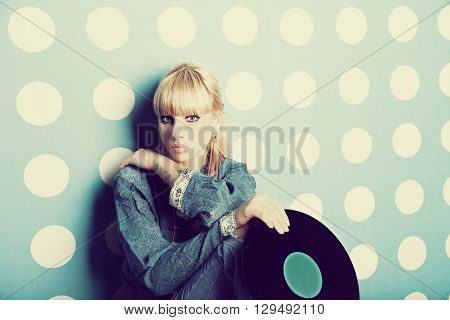 Portrait of a young girl with vinyl records in the hands