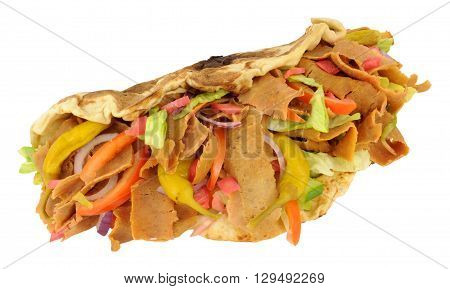 Take away Shawarma doner kebab with salad in a clay oven baked naan bread isolated on a white background
