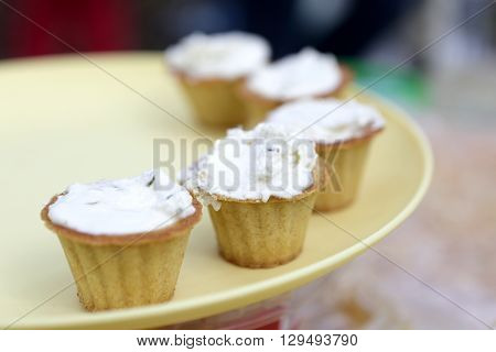 Tartlets With Cheese On Yellow Plate