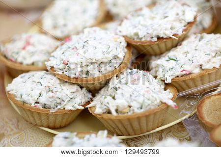 Tartlets With Salad On Yellow Plate