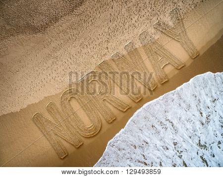 Norway written on the beach