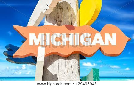 Michigan signpost with beach background