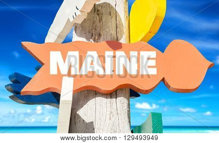 Maine signpost with beach background