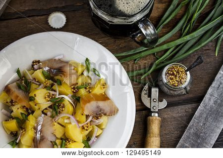 salad with potato green onions and smoked fish