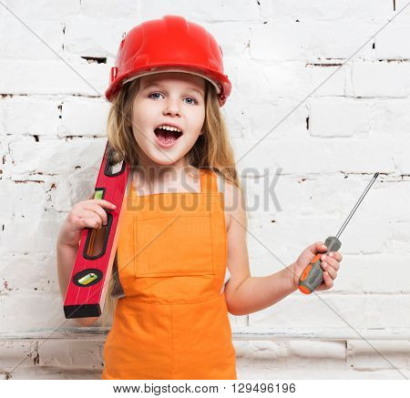 pretty girl-worker with builing level and screwdriver