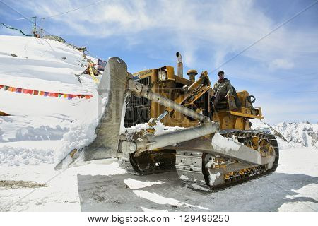 Khardung La Pass, India - April 21, 2016: Road works at Khardung La one of the highest motorable road (5360 m) in the world. The pass is strategically important to India.