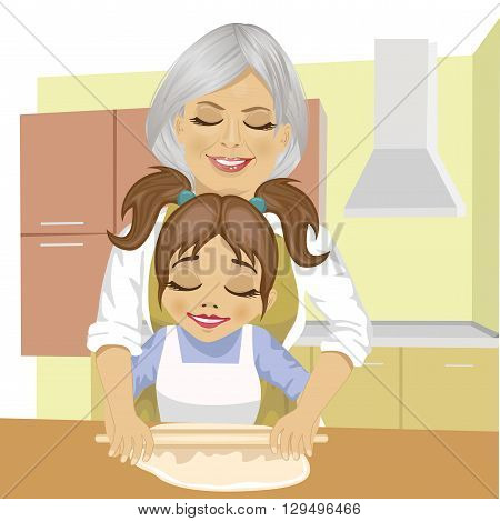 grandmother teaching granddaughter how to roll out the dough to cook a pizza in kitchen