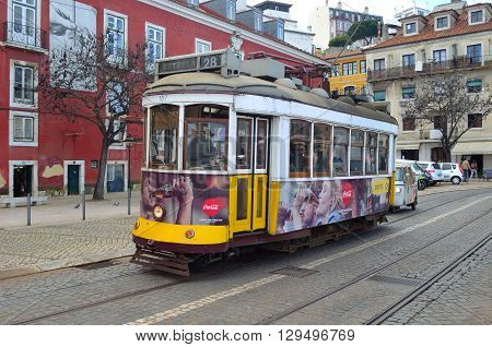 Lisbon, Portugal - March 02, 2016: Traditional old yellow Lisbon tram on Largo das Portas do Sol.