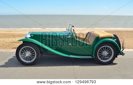 Felixstowe, Suffolk, England - May 01, 2016: Classic Green MG Sports car parked on seafront promenade.