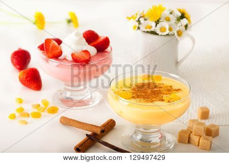 Strawberry pudding with whipping cream and vanilla pudding with cinnamon