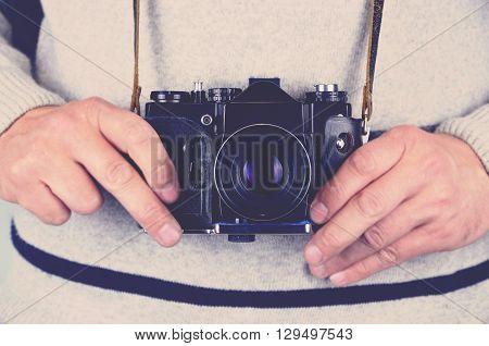 Man holding old fashion camera, vintage effect