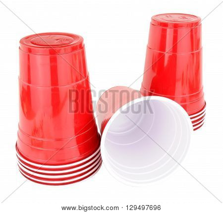 Group of red disposable plastic drinks cups isolated on a white background