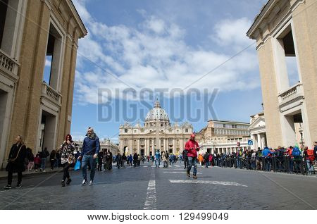 VATICAN CITY, VATICAN CITY STATE - APRIL 25: Low perspective image of tourists and St Peters Basilika in the Vatican City on April 25, 2016