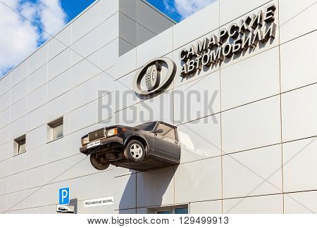 SAMARA RUSSIA - MAY 7 2016: Real car on the facade of the Car dealer selling cars of different brands