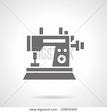 Sewing machine with small wheel. Industrial equipment for quality tailoring. Tailor profession and education. Symbolic black glyph style vector icon. Element for web design and mobile.
