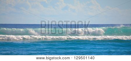 Warm tropical turquoise ocean waves.  Scenic destination Maui, Hawaii.