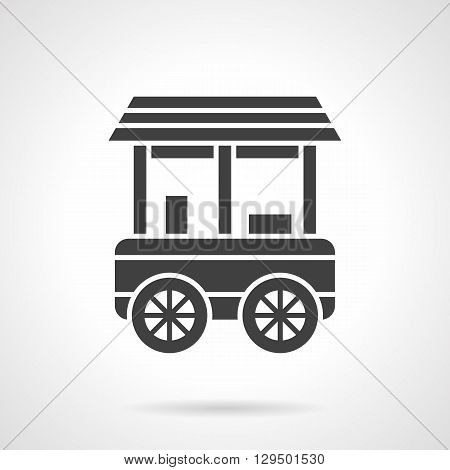 Wheel trailer for trading, delivery and sale of goods. Street sales food, desserts, snacks. City commerce. Symbolic black glyph style vector icon. Element for web design and mobile.
