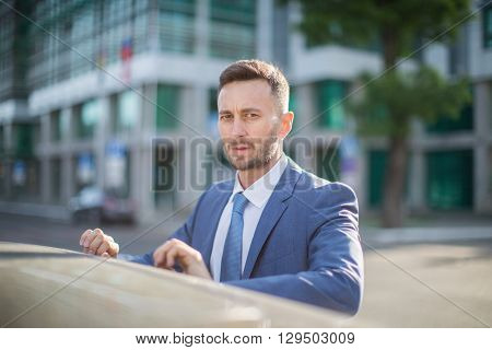 elegant businessman wearing modern suit blurred background with copy space for content or design