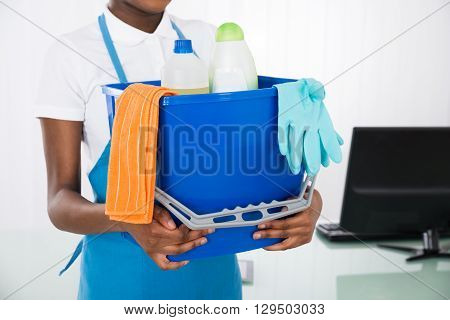 Close-up Of A Female Janitor Holding Cleaning Equipments