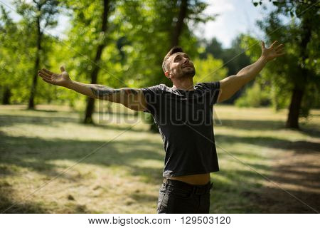 happy mature man outdoors resting on the meadow