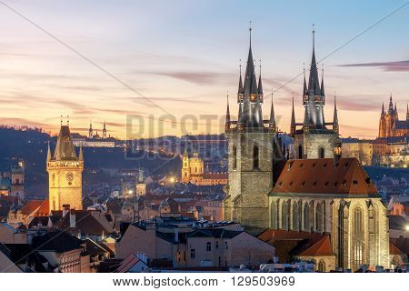 View of the Church of Our Lady before Tyn and St. Vitus Cathedral at sunset.