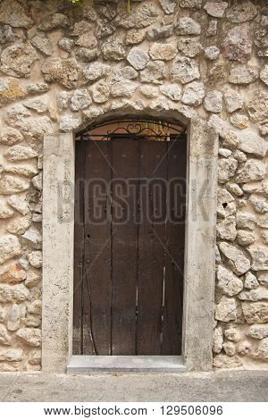 Old door in the ancient stone house