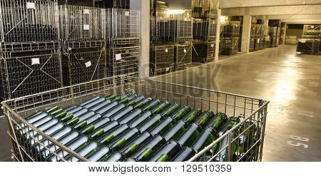 Wine bottles in wine cellar factory France