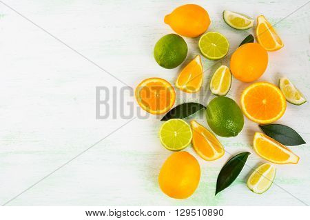 Citrus on light green background. Fruit background. Mixed fruit. Fresh fruit. Fresh food. Ripe fruit. Citrus fruit. Vegetarian food