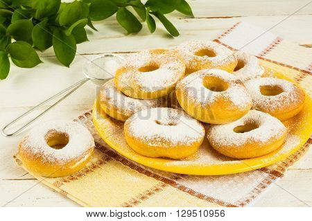 Donuts powdered by caster sugar. Doughnuts. Sweet pastry. Donuts. Sweet dessert.