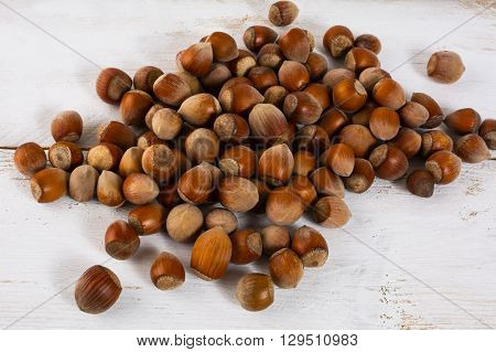 Hazelnuts on white wooden background. Nut. Healthy food. Snack. Nutrition. Healthy eating