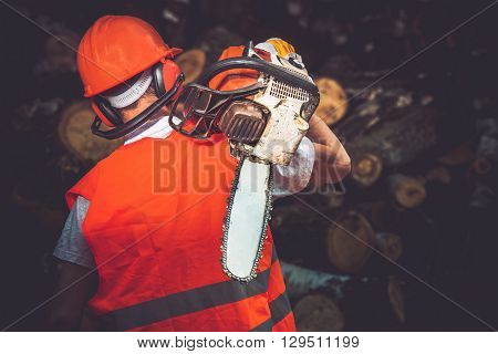 Hard Worker with Wood Cutter. Labor Concept Photo. Lumber Industry.